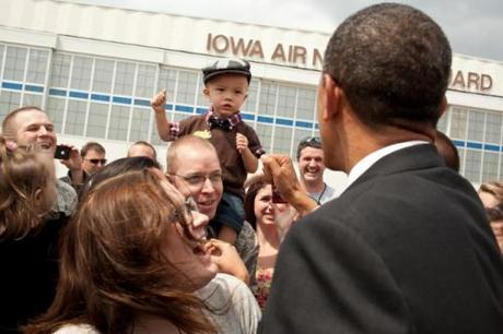 O greets people on the tarmac at Des Moines International Airport following his arrival in Des Moines, Iowa, May 24, 2012. (Pete Souza)