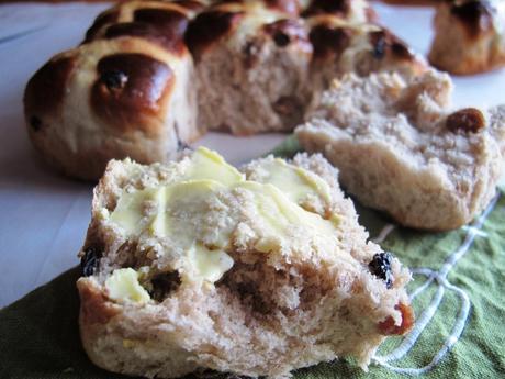 Half a hot cross bun with butter
