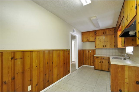 For me, knotty pine is beautiful in small doses. The original kitchen had more than what I prefer.