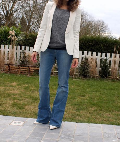 The flare jeans and the white wedge shoes