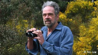 A photo of Australian biologist Tim Low with binoculars