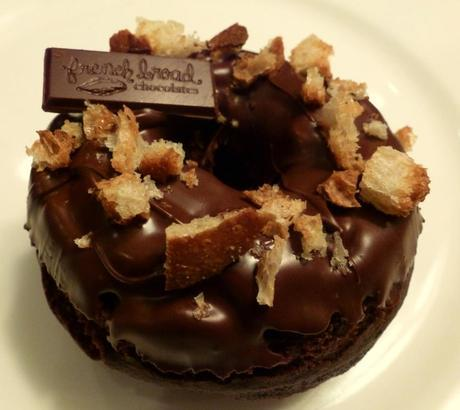 Paris of the South, a chocolate cake doughnut with a chocolate ganache topping, topped with buttery-toasted City Bakery baguette and a piece of French Broad Chocolate with a hint of coffee.