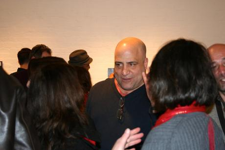 Gallery Owner Peter Surace charming his guests