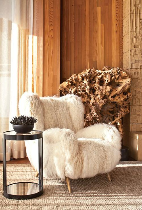 Kelly Wearstler beach house living room wood paneling fur covered chair driftwood