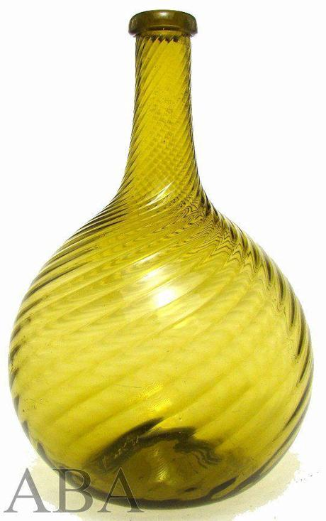 Molded Globular flask with spiral ribs - Lot 126 - American Bottle Auction