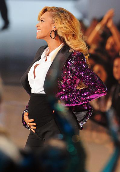 Beyonce and a brand-new baby bump light up a purple and sparkly 'Love On Top' performance at the 2011 MTV Video Music Awards in Los Angeles.