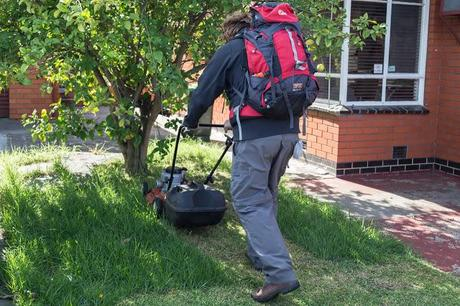 mowing lawn whilst wearing hiking clothes