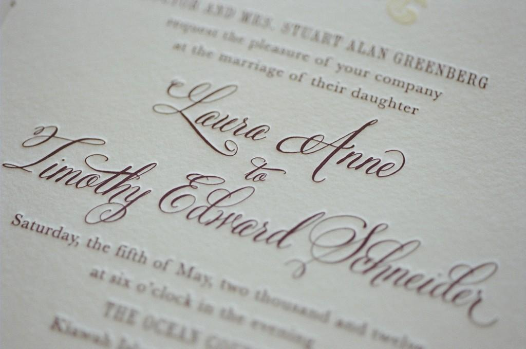 Letterpress wedding invitation with belluccia calligraphy