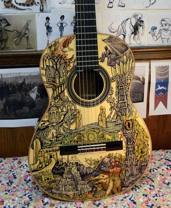 Acoustic guitar decorated with scenes from lord of the for Acoustic guitar decoration ideas