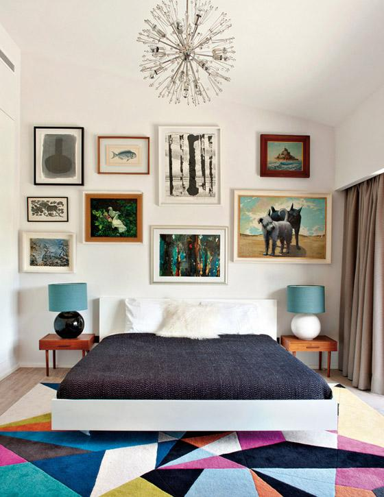 Portugal mod summer home, Nuno Benito, bedroom, gallery wall, colorful art, prism rug, sputnik chandelier