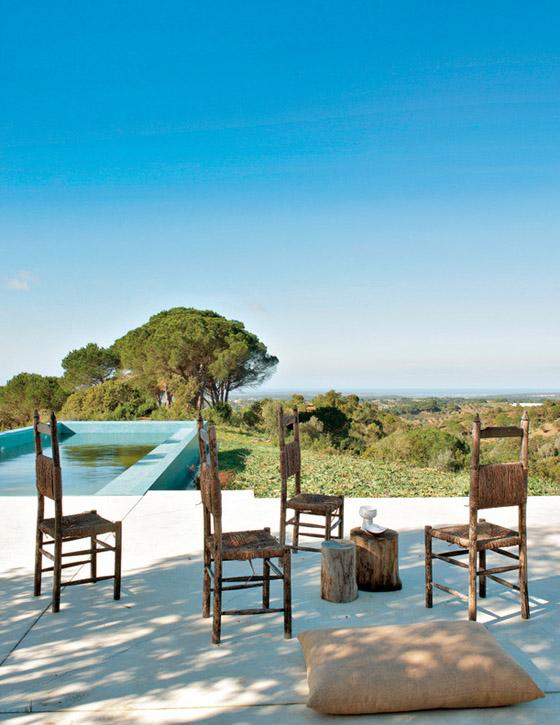 Portugal mod summer home, Nuno Benito, outdoor pool view, rustic chairs