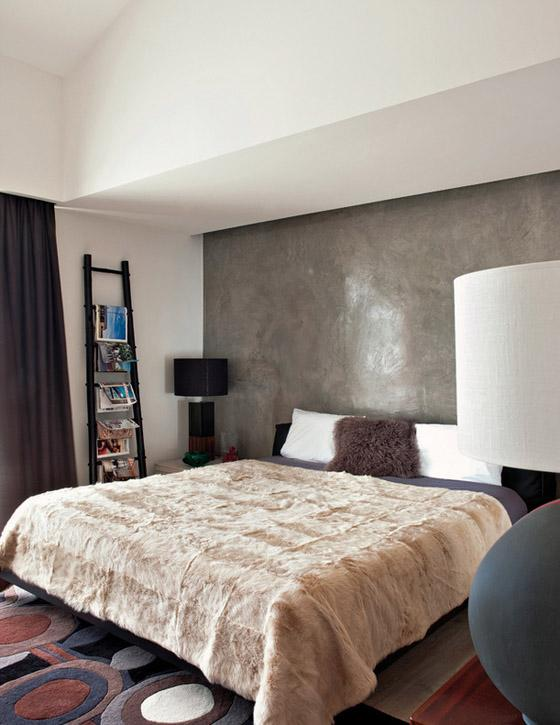 Portugal mod summer home, Nuno Benito, bedroom, cowhide bedspread, waxed Venetian plaster wall, fur pillow
