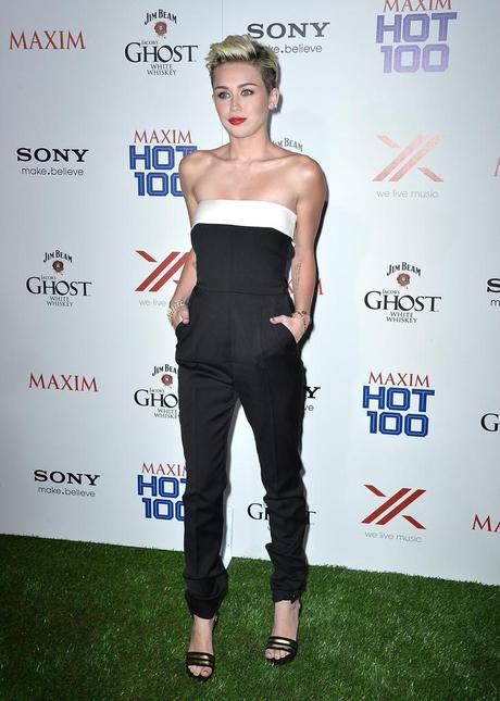 Miley Cyrus in Saint Laurent and Valentino at the 2013 Maxim Hot...