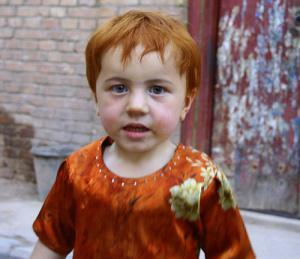 A very White looking, in fact, red-haired, Uighur child, who could easily be an Irish kid.