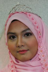 A classic Malay type, a very beautiful woman. Note the Muslim headscarf.