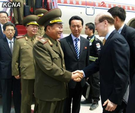 VMar Choe Ryong Hae (1) shakes hands with Liu Jieyi (2), deputy director of the Communist Party of China Central Committee International Liaison Department, after arriving in Beijing on 22 May 2013.  Also seen in attendance are Kim Song Nam (3) and Col. Gen. Ri Yong Gil (4) (Photo: KCNA).