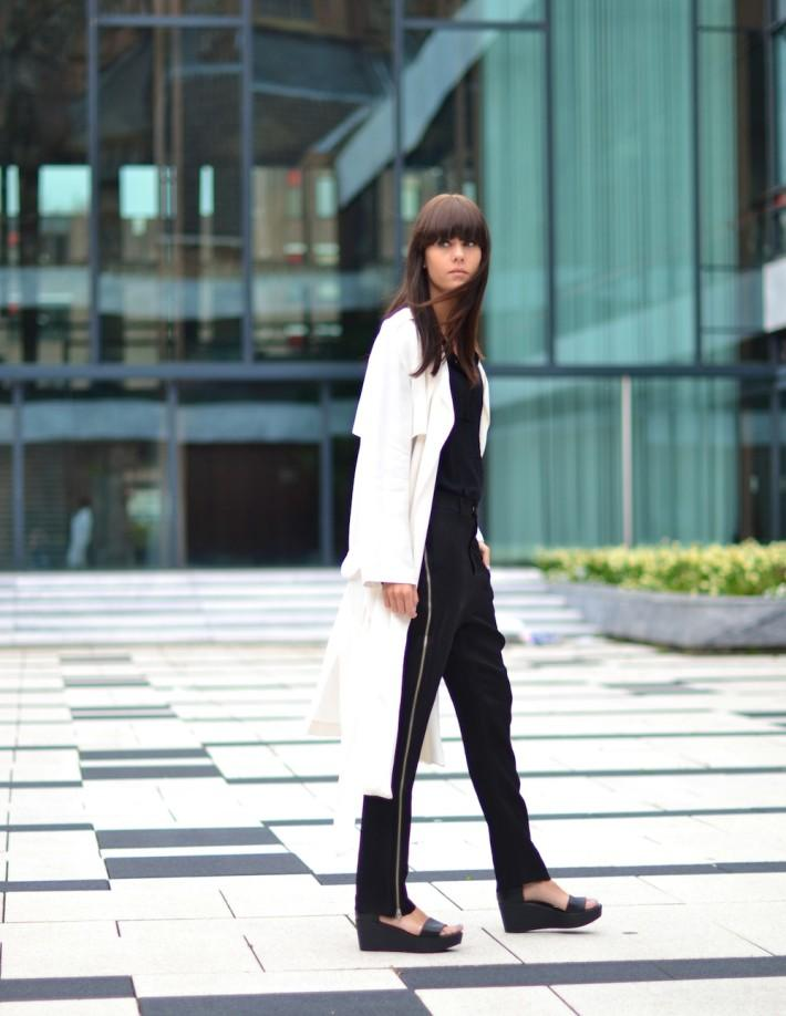 long white coat wide trousers and black flatforms