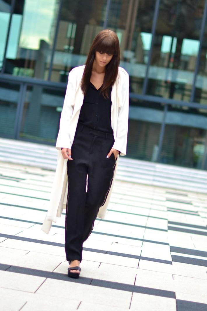 outfit black wide trousers white silky coat flatforms