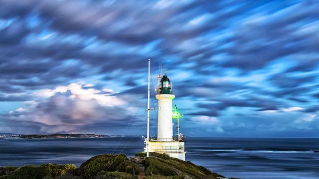 point lonsdale lighthouse and port phillip heads with moving clouds