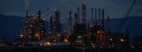 Oil refinery in Anacortes, Washington after dark with Mt. Baker in the background. (Credit: Flickr @ RVWithTito http://www.flickr.com/photos/rvwithtito/)