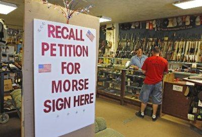 In this photo taken May 24, 2013, a large sign posted at the entrance of Paradise Firearms in Colorado Springs, Colo., invites customers to sign a recall petition against Colorado Democratic State Senate President John Morse.(Phot by: Ed Andrieski/AP Photo)