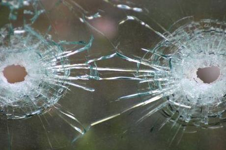 bullet_holes_in_glass