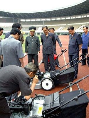 DPRK Cabinet Premier Pak Pong Ju (3rd R) inspects a lawn mower during his visit to the renovation of Yanggakdo Stadium in Pyongyang.  Also in attendance is DPRK Vice Premier and State Planning Commission Chairman Ro To Chol (2nd R) (Photo: Rodong Sinmun).