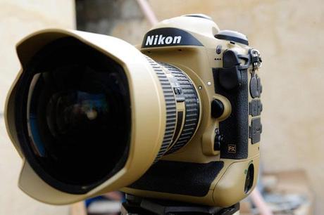 Photographer Gives His Nikon Gear a DIY Desert Mirage Lizard Paint Job viYLegm