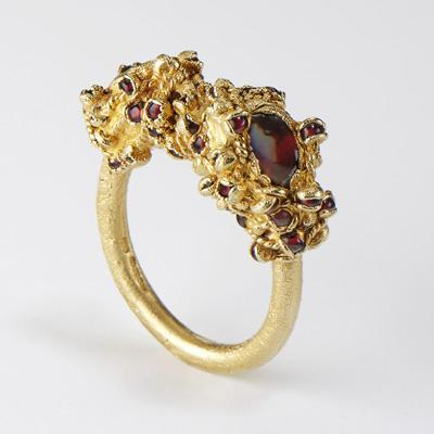 Ruth Tomlinson garnet and gold ring from hoard collection