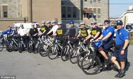 Chance encounter: More than two dozen police officers from various departments were taking part in an annual five-day bicycle school when they stumbled upon the kinky couple