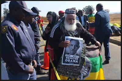 Angry Protesters Burn Obama's Picture In South Africa, Call Him A Killer (Video)
