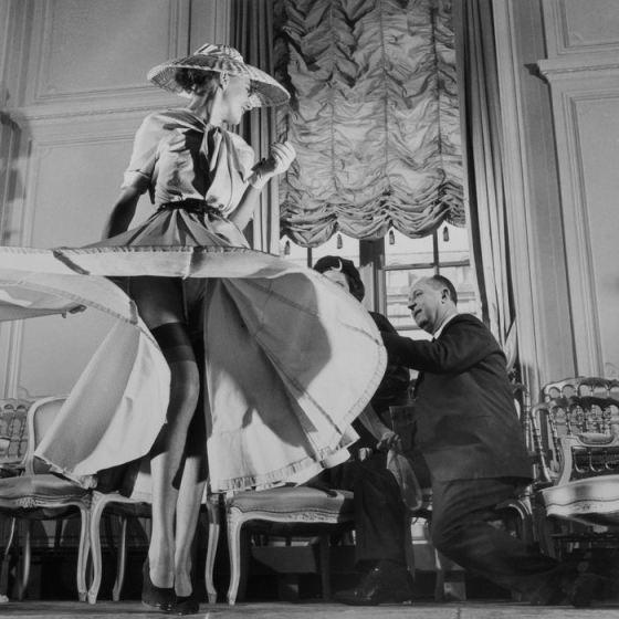 Christian Dior with Woman Modeling Dress