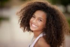 14738487-happy-smiling-african-descent-child-with-afro-hair-style