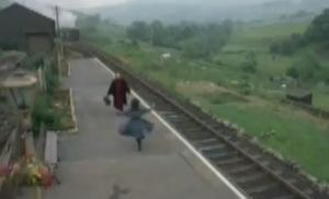 Roberta runs toward her returning father at the end of the 1970 screen adaptation of The Railway Children