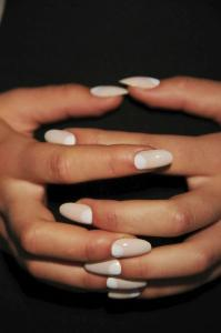 The half-moon manicure. Not quite nail art, but this shows extreme attention to detail
