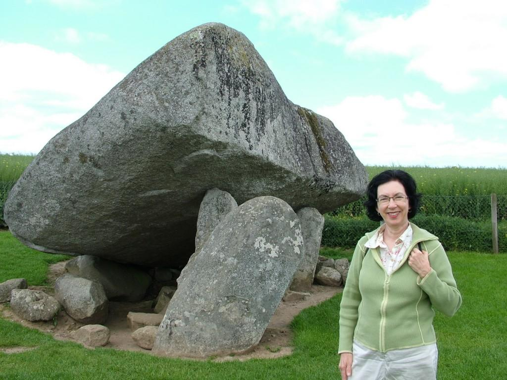 jean stands in front of the brownshill portal tomb -  county carlow - ireland