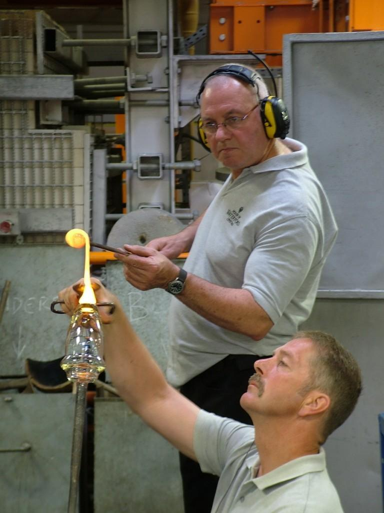 glass blowers work molten glass vase base - house of waterford crystal - waterford - ireland