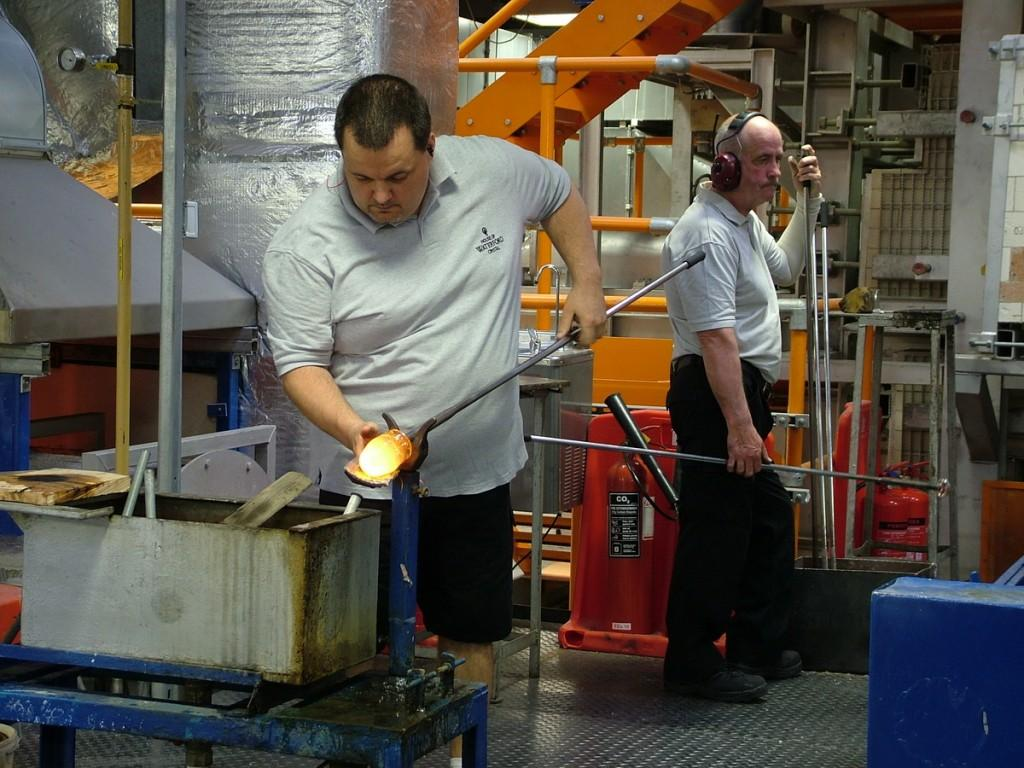 glass blower forming molten glass - house of waterford crystal - waterford - ireland