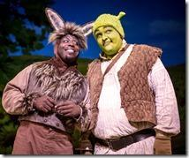 James Earl Jones II as Donkey and Michael Aaron Lindner as the lovable ogre Shrek become newfound friends on an adventure to rescue the Princess Fiona in Chicago Shakespeare Theater's production of Shrek The Musical, staged and choreographed by Rachel Rockwell. (photo credit: Liz Lauren)