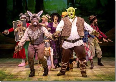 """James Earl Jones II as Donkey and Michael Aaron Lindner as Shrek with the ensemble of exiled fairy tale characters embracing their individuality in the song """"Freak Flag"""" in Chicago Shakespeare Theater's production of Shrek The Musical, staged and choreographed by Rachel Rockwell. (photo credit: Liz Lauren)"""