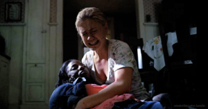 Sookie holds a wounded Tara in her arms in the season 4 finale of True Blood