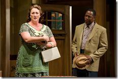 (left to right) Kirsten Fitzgerald and ensemble member James Vincent Meredith in Steppenwolf Theatre Company's production of Clybourne Park by Bruce Norris, directed by ensemble member Amy Morton.  Photo by Michael Brosilow.