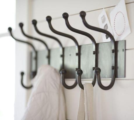 Lemon fresh laundry room makeover paperblog - Cast iron row of hooks ...
