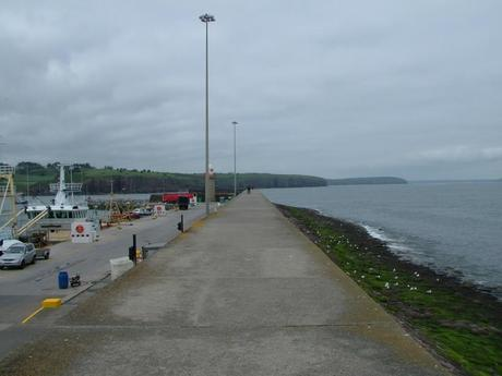 stormy clouds over harbor at dunmore east in county waterford - ireland