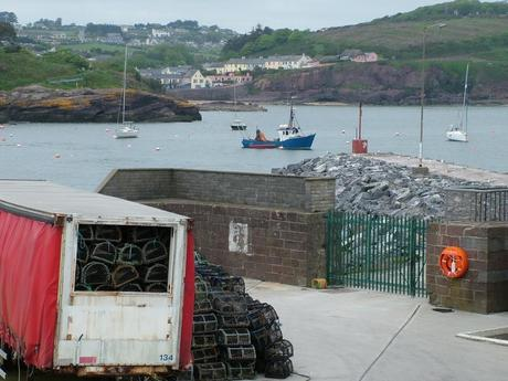 lobster traps sitting on main wharf at dunmore east in county waterford - ireland