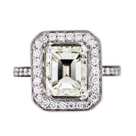 4 Carat Emerald Cut Diamond Platinum Engagement Ring in Halo Setting