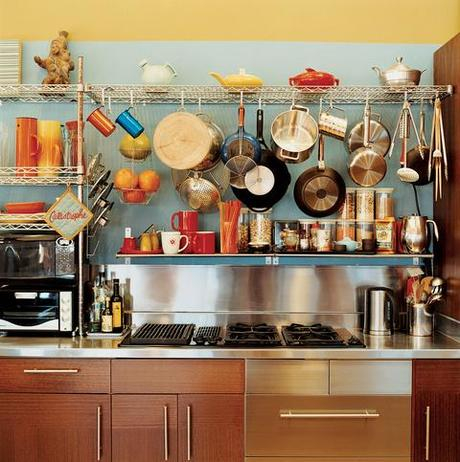 pots and pans hanging over stovetop open storage kitchen stove