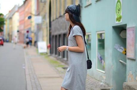 leather cap worn backwards