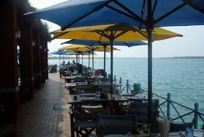 A picture of one of the restaurants there are within the sea like an island