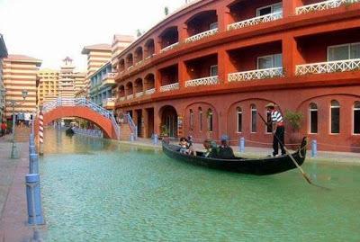 Family ride boat and Wandering around the Porto Marina, like in the Italian city of Venice